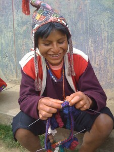 Young male from Chahuaytire community knitting chullo (hat).
