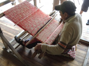 Jose´ hand weaves an ikat shawl on a modified backstrap loom.