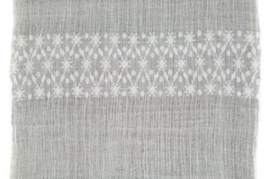 A sample of white-on-white brocade pattern.
