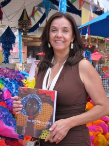 Carmella Padilla with The Work of Art (and a sea of Mexican paper flowers) at the Folk Art Market
