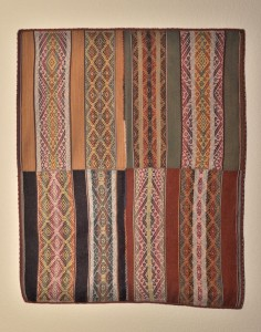 Peruvian textile properly mounted and displayed.