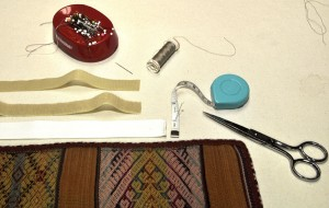 Basic supplies needed for mounting a textile.