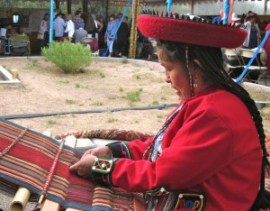 Peruvian weaver from the Centro de Textiles Tradicionales del Cusco at Folk Art Market.