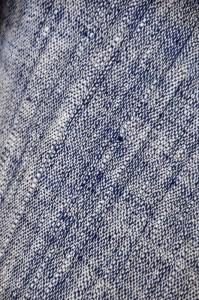Handspun, indigo-dyed and natural organic cotton handwoven into cloth.