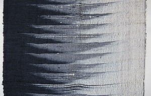 Detail of weft ikat pattern. Note the small loops on selvedge.