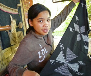 Mone Jouymany shows off her newly handwoven, traditional style, Katu cloth.