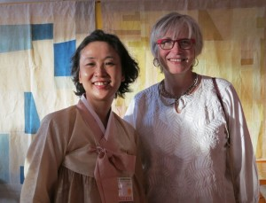 Korean artist Kim Sunghee with Marilyn Murphy standing in front of traditional naturally dyed patchwork cloth (pojagi).