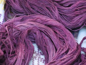 Purpura-dyed cotton yarn.