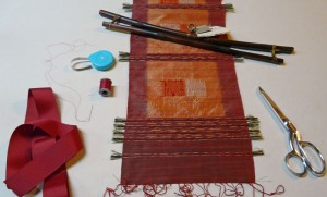 Supplies needed for inserting sleeve on back on textile.