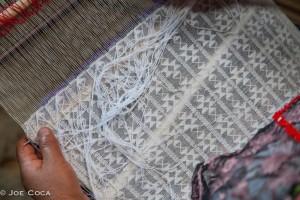 Brocade being woven on backstrap loom in Guatemala.