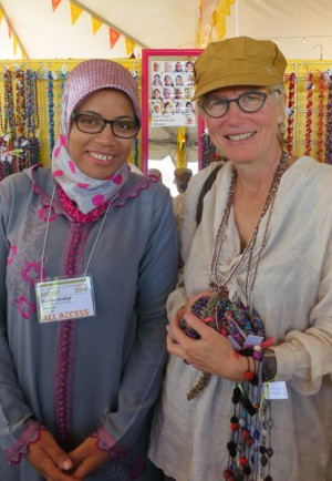 Rachida wears a traditional djellaba with hand-knotted buttons sewn on the front. (I'm on right with a bundle of the cooperative's new jewelry.)