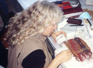 Judy Newland conducting textile analysis in Peru.